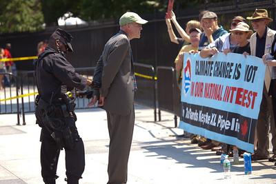 Police arrested Bill McKibben (left with green cap), the prominent climate activist and founder of 350.org. McKibben was among 65 environmentalists arrested on August 20, 2011, outside the White House in Washington DC, as part of a demonstration urging President Obama to block the proposed Keystone XL pipeline that would bring oil from Canada's oil sands projects to Gulf Coast refineries. The proposed $7 billion, 1,700 mile pipeline needs State Department approval to proceed, and the Obama administration plans to make a decision by the end of the year. This latest act of civil disobedience was the beginning of  two weeks of White House demonstrations, with more arrests expected daily. Among those arrested on August 20 were Gus Speth, whose career includes co-founding the Natural Resources Defense Council and chairing the White House Council on Environmental Quality in the Carter Administration; and Jane Hamsher, who founded the popular progressive blog Firedoglake. (Photo by Jeff Malet)