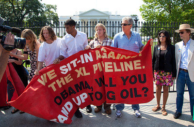 "Police arrested 65 environmentalists on August 20, 2011, outside the White House in Washington DC, as part of a demonstration urging President Obama to block the proposed Keystone XL pipeline that would bring oil from Canada's oil sands projects to Gulf Coast refineries. The proposed $7 billion, 1,700 mile pipeline needs State Department approval to proceed, and the Obama administration plans to make a decision by the end of the year. This latest act of civil disobedience was the beginning of  two weeks of White House demonstrations, with more arrests expected daily. Among those arrested on August 20 were Bill McKibben, the prominent climate activist and founder of 350.org; Gus Speth, whose career includes co-founding the Natural Resources Defense Council and chairing the White House Council on Environmental Quality in the Carter Administration; and Jane Hamsher, who founded the popular progressive blog Firedoglake. Sign in photo reads ""We Sit-In Against the XL Pipeline. Obama, Will You Stand Up to Big Oil?"" (Photo by Jeff Malet)"