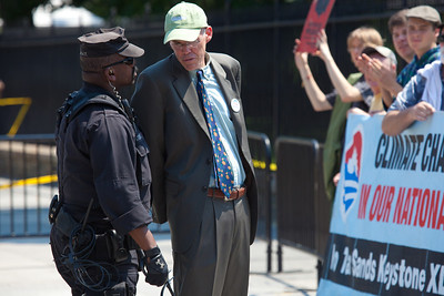 Police arrested Bill McKibben, the prominent climate activist and founder of 350.org. He was among 65 environmentalists arrested on August 20, 2011, outside the White House in Washington DC, as part of a demonstration urging President Obama to block the proposed Keystone XL pipeline that would bring oil from Canada's oil sands projects to Gulf Coast refineries. The proposed $7 billion, 1,700 mile pipeline needs State Department approval to proceed, and the Obama administration plans to make a decision by the end of the year. This latest act of civil disobedience was the beginning of  two weeks of White House demonstrations, with more arrests expected daily. Among those arrested on August 20 were Gus Speth, whose career includes co-founding the Natural Resources Defense Council and chairing the White House Council on Environmental Quality in the Carter Administration; and Jane Hamsher, who founded the popular progressive blog Firedoglake. (Photo by Jeff Malet)