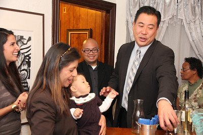 2nd from left, Alexandra Siliezar, with child.  2nd from right, Paul Miyamoto, Sheriff's Department Captain and candidate for Sheriff.