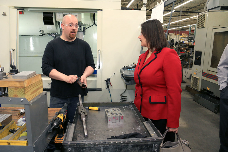 Rocheleau Tool & Die Company Inc. was the first stop Tuesday morning on a tour for educators, school officials and local politicians to see how manufacturing company's work in the region to help strengthen the relationship between the school and the companies. Senator Jennifer Flanagan chats with Machinist Kevin Kaiser about his job during the tour of the company. SENTINEL& ENTERPRISE/JOHN LOVE