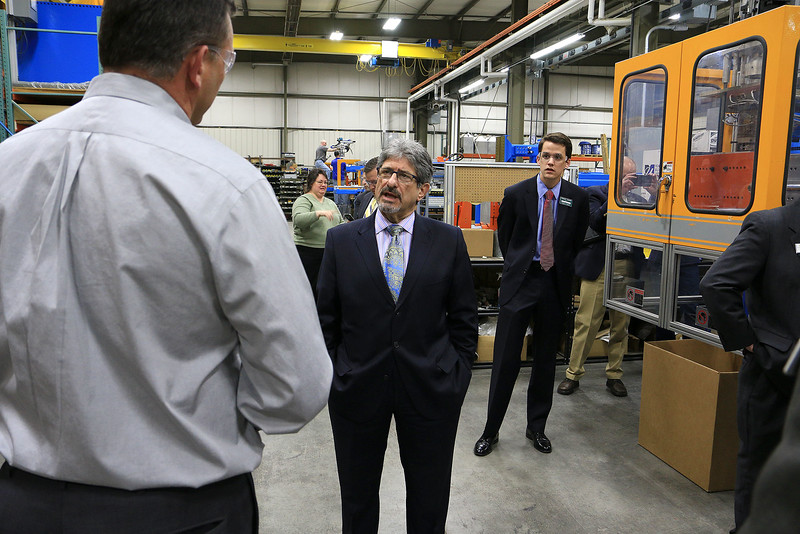 Rocheleau Tool & Die Company Inc. was the first stop Tuesday morning on a tour for educators, school officials and local politicians to see how manufacturing company's work in the region to help strengthen the relationship between the school and the companies. Asking some questions of President Steve Rocheleau is Fitchburg Mayor Stephen DiNatale. SENTINEL& ENTERPRISE/JOHN LOVE