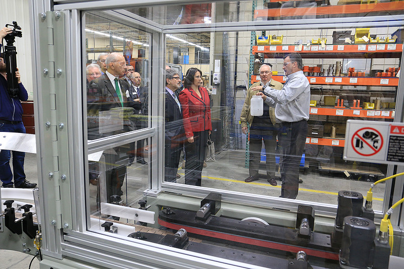 Rocheleau Tool & Die Company Inc. was the first stop Tuesday morning on a tour for educators, school officials and local politicians to see how manufacturing company's work in the region to help strengthen the relationship between the school and the companies. President of Rocheleau's Steve Rocheleau seen through one of his machines leads the tour and explains what they do and how things work at his company. SENTINEL& ENTERPRISE/JOHN LOVE
