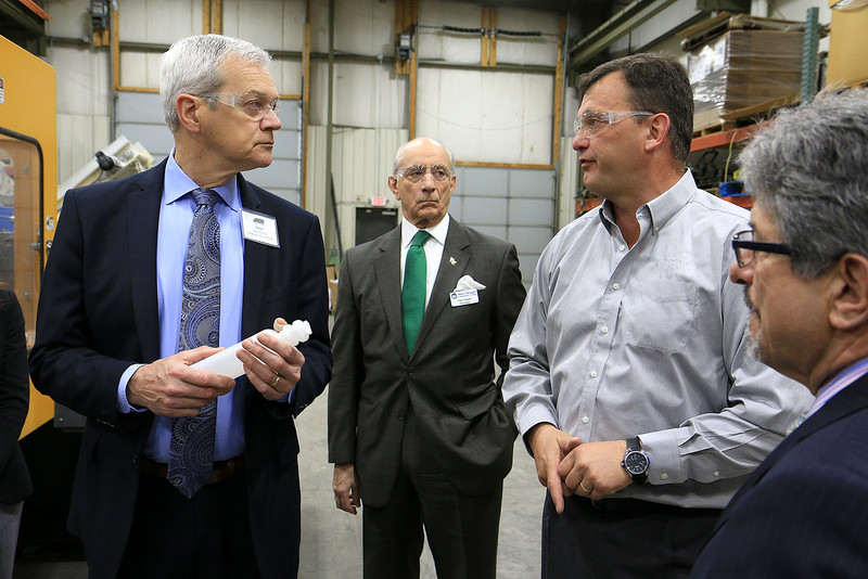 Rocheleau Tool & Die Company Inc. was the first stop Tuesday morning on a tour for educators, school officials and local politicians to see how manufacturing company's work in the region to help strengthen the relationship between the school and the companies. Listing to President Steve Rocheleau, second from right is from left Fitchburg School District Superintendent Andre Ravenelle, Mount Wachusett Community College President Daniel Asquino and Fitchburg Mayor Stephen DiNatale. SENTINEL& ENTERPRISE/JOHN LOVE