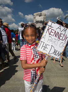 Six year old Kennedy from Columbia MD holding a sign she crafted herself (she was named after the 35th president). Here standing at Martin Luther King Jr. Memorial.