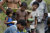 Children line up for food at a camp of the Landless Workers Movement (MST) in the northeastern Brazilian state of Pernambuco. The MST has ended its honeymoon with President Luiz Inacio Lula da Silva, who they supported in the 2002 election, and has begun a campaign of land invasions to speed up agrarian reform. The MST says lula is slow on reform an invasions are the only way to pressure the government. Founded in 1985, the Landless Workers Movement is the largest social movement in Latin America and one of the most successful grassroots movements in the world. Hundreds of thousands of landless peasants have taken onto themselves the task of carrying out a land reform in a country mired by an overly skewed land distribution pattern.  Less than 3% of the population owns two-thirds of Brasil's arable land.  Under Brazil's constitution, the government must redistribute farmland that is unused. Today more than 250,000 families have won land titles to over 15 million acres after MST land takeovers. (Australfoto/Douglas Engle)