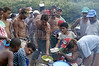 Members of the Landless Workers Movement (MST) line up for food at a camp in the northeastern Brazilian state of Pernambuco. The MST has ended its honeymoon with President Luiz Inacio Lula da Silva, who they supported in the 2002 election, and has begun a campaign of land invasions to speed up agrarian reform. The MST says lula is slow on reform an invasions are the only way to pressure the government. Founded in 1985, the Landless Workers Movement is the largest social movement in Latin America and one of the most successful grassroots movements in the world. Hundreds of thousands of landless peasants have taken onto themselves the task of carrying out a land reform in a country mired by an overly skewed land distribution pattern.  Less than 3% of the population owns two-thirds of Brasil's arable land.  Under Brazil's constitution, the government must redistribute farmland that is unused. Today more than 250,000 families have won land titles to over 15 million acres after MST land takeovers. (Australfoto/Douglas Engle)