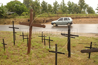 A car passes a memorial to Landless Peasant (MST) massacre victims, made of 19 crosses, on the side of the PA-150 highway near Carajas in southern Par‡ state, Brazi. In what ins now known as the Carajas Massacre, 19 MST members were killed April 19, 1996 when state police opened fire on hundreds of protesting MST members who had blocked the highway to demand land reform. Other two victims died from the wounds some years later. (Australfoto/Douglas Engle)