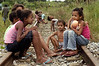 Children sit on a train track near a Landless Workers Movement (MST) camp in the northeastern Brazilian state of Pernambuco. The MST has ended its honeymoon with President Luiz Inacio Lula da Silva, who they supported in the 2002 election, and has begun a campaign of land invasions to speed up agrarian reform. The MST says lula is slow on reform an invasions are the only way to pressure the government. Founded in 1985, the Landless Workers Movement is the largest social movement in Latin America and one of the most successful grassroots movements in the world. Hundreds of thousands of landless peasants have taken onto themselves the task of carrying out a land reform in a country mired by an overly skewed land distribution pattern.  Less than 3% of the population owns two-thirds of Brasil's arable land.  Under Brazil's constitution, the government must redistribute farmland that is unused. Today more than 250,000 families have won land titles to over 15 million acres after MST land takeovers. (Australfoto/Douglas Engle)
