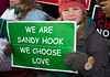 March on Washington for Gun Control (2013) : Wearing the green and white colors of Sandy Hook Elementary School where 26 children and adults were killed, 100 residents from Newtown, Connecticut joined thousands of other gun-control activists on Saturday, January 26, 2013 in Washington D.C. in a march down Constitution Ave. to a rally with speeches, musical performances and a poetry reading near the Washington Monument. The rally was organized by Molly Smith, the artistic director of Arena Stage, along with her partner, American Indian activist Suzanne Blue Star Boy. Co-sponsors included One Million Moms for Gun Control, Washington National Cathedral, Foundry United Methodist Church in the District and Trinity United Church of Christ in Chicago.  Speakers at the rally included Education Secretary Arne Duncan; actress Kathleen Turner; Rep. Chris Van Hollen; Del. Eleanor Holmes Norton; D.C. Mayor Vincent C. Gray; activist Colin Goddard, survivor of Virginia Tech, Marty Isaac, President at Connecticut Against Gun Violence; and One Million Moms for Gun Control founder Shannon Watts.