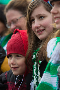 Young Noah and Sophie Ackert from Newtown, CT peer from the front row at a rally for gun-control. Wearing the green and white colors of Sandy Hook Elementary School where 26 children and adults were killed, 100 residents from Newtown, Connecticut joined thousands of other gun-control activists on Saturday, January 26, 2013 in Washington D.C. in a march down Constitution Ave. to a rally with speeches, musical performances and a poetry reading near the Washington Monument. (Photo by Jeff Malet)