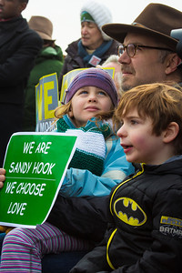 6 year-old Marie Therese Morosky from Newtown CT peers from the back row of the VIP section on the lap of her dad Andrew Morosky at a gun-control rally in Washington D.C. She personally knew 4 of the slain children at Sandy Hook Elementary. Wearing the green and white colors of Sandy Hook Elementary School where 26 children and adults were killed, 100 residents from Newtown, Connecticut joined thousands of other gun-control activists on Saturday, January 26, 2013 in Washington D.C. in a march down Constitution Ave. to a rally with speeches, musical performances and a poetry reading near the Washington Monument. (Photo by Jeff Malet)