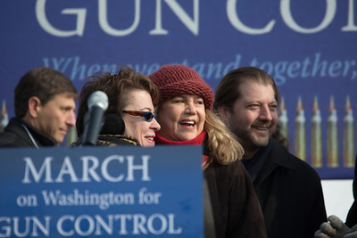 Film actress and activist Kathleen Turner (center) receives hugs after addressing a gun-control rally in Washington D.C. 100 residents from Newtown, Connecticut joined thousands of other gun-control activists on Saturday, January 26, 2013 in Washington D.C. in a march down Constitution Ave. to the rally with speeches, musical performances and a poetry reading near the Washington Monument. (Photo by Jeff Malet)