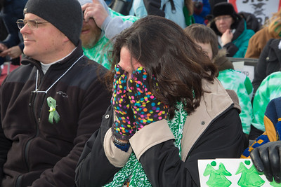 "Joan Huskins, the mother of four children who graduated from the Sandy Hook Elementary School, is overcome with emotion during the singing of John Lennon's song ""Imagine"". Wearing the green and white colors of Sandy Hook Elementary School where 26 children and adults were killed, 100 residents from Newtown, Connecticut joined thousands of other gun-control activists on Saturday, January 26, 2013 in Washington D.C. in a march down Constitution Ave. to a rally with speeches, musical performances and a poetry reading near the Washington Monument. (Photo by Jeff Malet)"