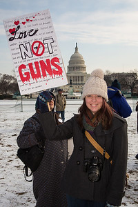 "Marie from Wichita KS says ""Love, Not Guns"", in front of the U.S. Capitol. Approximately 100 residents from Newtown, Connecticut, the scene of a school massacre in which 20 children and six adults were killed last month, joined thousands of other anti gun violence activists on Saturday, January 26, 2013 in Washington D.C. in a march and rally on the National Mall in support of gun-control measures. (Photo by Jeff Malet)"