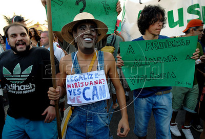 """A young with a mask of the US president Barack Obama march in favour of the legalization of cannabis during the Global Marijuana March at Ipanema beach, Rio de Janeiro, Brazil, May 9, 2009. The banner reads """"The prohibition foment the violence"""". (Austral Foto/Renzo Gostoli)"""