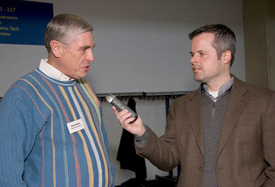 State Representative Robert Pritchard (left, R-Hinckley) chats with syndicated radio host Michael Koolidge after a town hall meeting at the Stenstrom Center of Rock Valley College in Rockford, Illinois on Saturday, January 22, 2011.