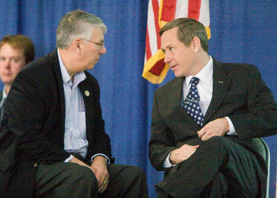 Congressman Don Manzullo (left, R-Egan) and United States Senator Mark Kirk (R-Illinois) chat briefly at a town hall meeting at the Stenstrom Center of Rock Valley College in Rockford, Illinois on Saturday, January 22, 2011.