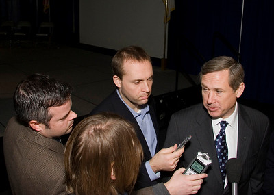 Syndicated radio host Michael Koolidge (left) asks United States Senator Mark Kirk (R-Illinois) a question after a town hall meeting at the Stenstrom Center of Rock Valley College in Rockford, Illinois on Saturday, January 22, 2011.