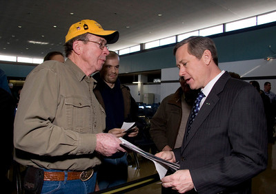 United States Senator Mark Kirk (right, R-Illinois) meets with constituents after a town hall meeting at the Stenstrom Center of Rock Valley College in Rockford, Illinois on Saturday, January 22, 2011.
