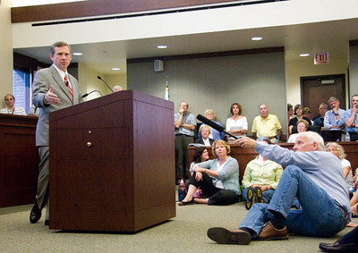 Congressman Mark Kirk (R-IL10) addresses a crowd during his town hall meeting on health care reform at the Arlington Heights Village Hall on Monday, August 24, 2009.