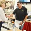 Martha Coakley greets diner owner Bob Rizk at the Sunrise Diner in Fitchburg on Saturday morning. SENTINEL & ENTERPRISE / Ashley Green