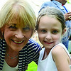 Candidate for Governor Martha Coakley greets guests at the home of Joe and Lynda Byrne on Saturday afternoon. Mrs. Byrne is the Fitchburg Democratic City Committee Chairwoman. Coakley smiles for a photo with 5-year-old Olivia Martin. SENTINEL & ENTERPRISE / Ashley Green