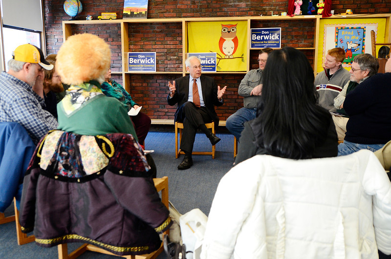 Massachusetts Democratic gubernatorial candidate Dr. Donald Berwick (center) talks in an intimate group setting while campaigning at the Fitchburg Public Library, Saturday. <br /> SENTINEL & ENTERPRISE / BRETT CRAWFORD