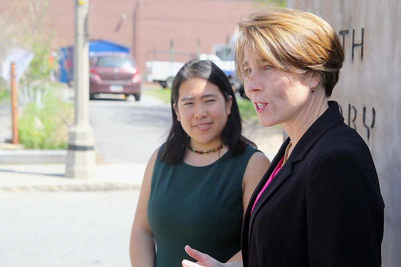 Maura Healey address a small crowd as Fitchburg Mayor Lisa Wong listens on after endorsing her for Attorney General on Monday at the Fitchburg Public Library.  SENTINEL & ENTERPRISE/JOHN LOVE