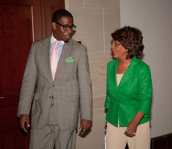 Rep. Maxine Waters (D-CA) holds a news conference at the Capitol to challenge the charges made against her by the House Ethics Committee. Here entering the press conference, Chief of Staff Mikael Moore and Rep. Waters.  Waters denied that she used her influence to aid a bank in which her husband has a financial interest. She also attacked ethics investigators for drawing the wrong conclusions from what she said was her lifetime work of trying to aid minority-owned businesses in general. Washington DC, August 13, 2010. (Photo by Jeff Malet)