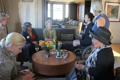 Clockwise from upper left: Lisa Peters, Helynna Brooke, Marilyn Fowler, Michela Alioto-Pier, Lynne Newhouse Segal (standing), Lara Arguelles (black hat), Sarah Geller.