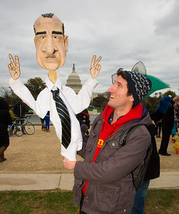 Noah Langer of Washington DC holds a puppet of former President Richard Nixon. Langer supports the National Endowment for the Arts (NEA) and Public Broadcasting (as Nixon did).