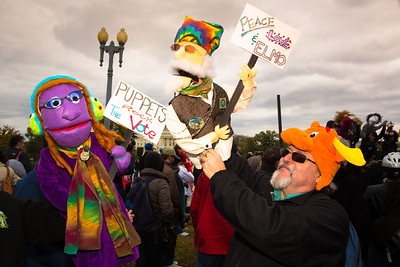 Linda and Mike Dennis of Churchton MD with puppets Janice and Rocky