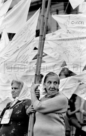 Women, militans of Argentina's Mothers of Plaza de Mayo group, whose children disappeared during the dirty war of 1970s, participate in a march in Buenos Aires's Plaza de Mayo, Buenos Aires, Argentina, April 30, 1987.  (Austral Foto/Renzo Gostoli)