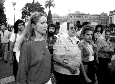Swedish actress Liv Ullmann, left, and Hebe de Bonafini participate at a march of Mothers of Plaza de Mayo group, whose children disappeared during the dirty war of 1970s in Buenos Aires's Plaza de Mayo, Buenos Aires, Argentina, December, 1987. (Austral Foto/Renzo Gostoli)