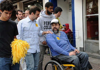 Marcelo Freixo, left, Rio de Janeiro's municipal candidate for the PSOL party and  Marcelo Yuka, right in wheelchair, Vice-candidate during a campaign rally in Tijuca district, Rio de Janeiro, Brazil, september 27, 2012. (Austral Foto/Renzo Gostoli)