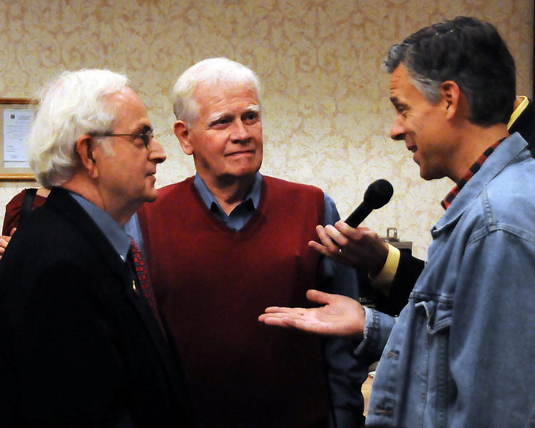 Former Utah governor & ambassador to China, Jon Huntsman, talks with NH District 4 Representative, David Knox, of Wolfeboro, and Steve Knox, of Albany, NH, at the North Conway Grand Hotel, during a breakfast event, in North Conway, NH, on June 4th, 2011.