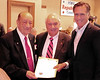 Ray Abbott (right), is presented a commendation, in honor of his recent 80th birthday, from the NH Legislature, by Executive Councilor Ray Burton, and signed by Mitt Romney (right), former governor of Massachusetts, and 2008 Republican Presidential candidate. Mr Romney was the keynote speaker at the Carroll County Republican Committee Lincoln Day Dinner, held at the Attitash Grand Summit Hotel, on March 5th, 2011.