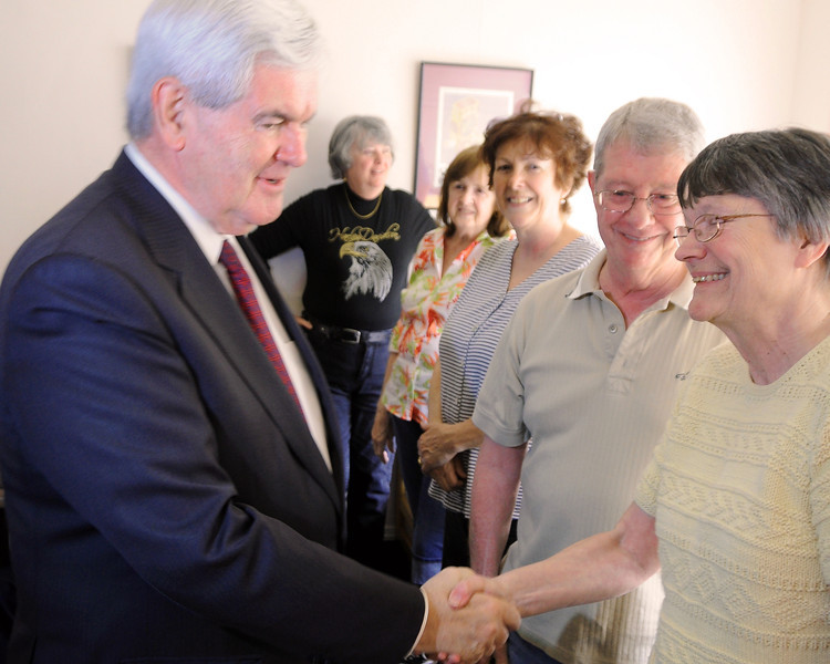 Newt Gingrich, Republican Presidential candidate in 2012, shakes hands with NH Carroll County District 1 Representative, Karen Umberger, as husband Jim looks on, during a campaign appearance at Joe Quirk's Conway Cafe, in Conway, NH, on May 26th, 2011.