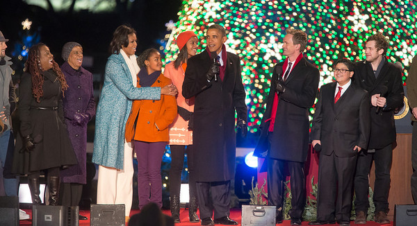 President Obama appears onstage with entertainers at the 90th annual National Christmas Tree Lighting Ceremony on the Ellipse, just south of the White House in Washington D.C. on December 6, 2012. Left to right in photo, Jason Mraz, Ledisi, Michelle, Sasha, Malia and Barack Obama, Neil Patrick Harris, Rico Rodriguez, Phillip Phillips. (Photo by Jeff Malet)