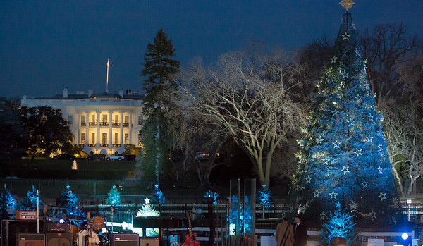 With the White House in the background, the National Christmas Tree waits to be lit.  Barack Obama and the First Family later flicked the switch to light up the National Christmas Tree  before an estimated crowd of 17,000 on the Ellipse, near the White House in Washington D.C. on December 6, 2012  (Photo by Jeff Malet)