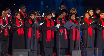 Members of the Washington Performing Arts Society gospel choir perform at the 90th annual lighting of the National Christmas Tree. President Barack Obama and the First Family flicked the switch to light up the tree before an estimated crowd of 17,000 on the Ellipse, near the White House in Washington D.C. on December 6, 2012  (Photo by Jeff Malet)