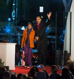 President Barack Obama and younger daughter Sasha make their entrance at the 90th annual National Christmas Tree Lighting Ceremony. Sasha later flicked the switch to light up the National Christmas Tree  before an estimated crowd of 17,000 on the Ellipse, just south of the White House in Washington D.C. on December 6, 2012  (Photo by Jeff Malet)