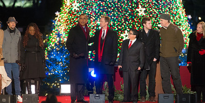 President Obama appears onstage with entertainers at the 90th annual National Christmas Tree Lighting Ceremony on the Ellipse, just south of the White House in Washington D.C. on December 6, 2012. Left to right in photo, Jason Mraz, Ledisi, Barack Obama, Neil Patrick Harris, Rico Rodriguez, Phillip Phillips, and James Taylor. (Photo by Jeff Malet)