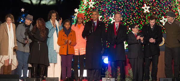 President Obama appears onstage with entertainers at the 90th annual National Christmas Tree Lighting Ceremony on the Ellipse, just south of the White House in Washington D.C. on December 6, 2012. Left to right in photo, Colbie Caillat, Jason Mraz, Ledisi, Michelle, Sasha, Malia and Barack Obama, Neil Patrick Harris, Rico Rodriguez, Phillip Phillips, and James Taylor. (Photo by Jeff Malet)
