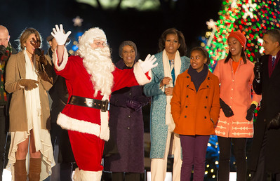 The First Family appears onstage with Santa and entertainers at the 90th annual National Christmas Tree Lighting Ceremony on the Ellipse, just south of the White House in Washington D.C. on December 6, 2012. Left to right in photo,Colbie Caillat, mother-in-law Marian Robinson, Michelle, Sasha, Malia and President Barack Obama. (Photo by Jeff Malet)