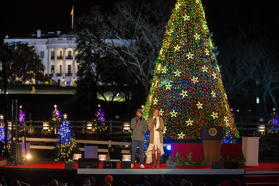 With the White House in the background, the National Christmas Tree is lit for the first time this season. Barack Obama and the First Family flicked the switch to light up the tree  before an estimated crowd of 17,000 on the Ellipse, just south of the White House in Washington D.C. on December 6, 2012.  (Photo by Jeff Malet)