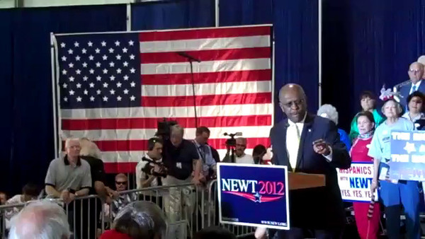 Herman Caine, former presidential candidate, speaks at the Newt Gingrich rally in Tampa, FL.
