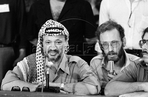 Palestinian leader Yasser Arafat, left, participates at a meeting with Nicaraguan leader sandinist and member of Nicaraguan assembly, Managua, Nicaragua, July 21, 1980. (Austral Foto/Renzo Gostoli)