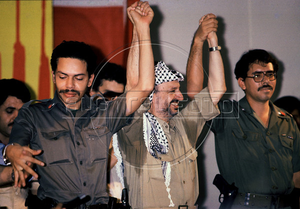 Palestinian leader Yasser Arafat, center, participates at a meeting with Nicaraguan leader sandinist and member of Nicaraguan assembly Daniel Ortega, right, Managua, Nicaragua, July 17, 1980. (Austral Foto/Renzo Gostoli)
